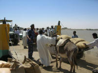 Loading the ferry - donkey carts come last