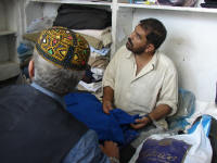 Tailor discussing making my shalwaar kameez