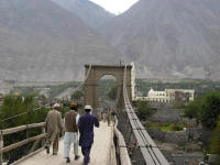 Suspension Bridge at Gilgit. You step fro solid ground onto a swaying bridge. Quite an experience.