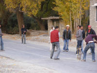 Playing cricket on the Karakorum Highway, shows how much traffic is expected!