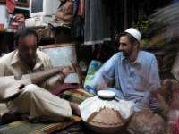Listening to the Rabab (stringed instrument) and the abla (drum)