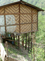 Bamboo slat house built on a slope