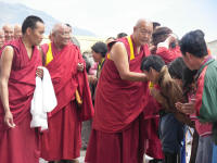Being blessed by the Rinpoche, head of the monastary