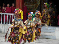 Dancers entering the dance area from the Gompa