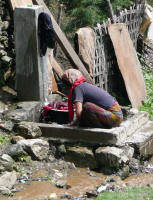 Washing clothes in a mountain stream on the road (Jay)