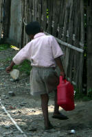 Young boy fetching water (Jay)