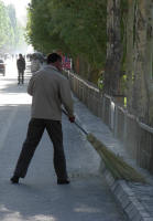 A street sweeper - unusual after Pakistan and India
