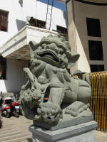 One of a pair of lions guard the Chini Bagh. Pairs of lions guard many buildings in China