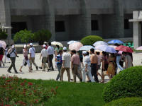 Chinese tourists and the ever present umbrellas