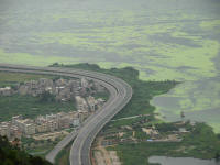 The lake with algae and housing developments