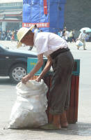 Same old man collecting empty plastic bottles. One of the poor. (John)