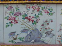 painted tile decoration on verandah wall