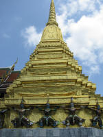 A chedi held up by Garudas