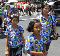 Colourful school uniform worn by boys, girls and teachers.