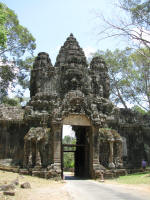 The Victory Gate of Angkor Thom. If you look closely you can see the head on the centre tower. There are elephants at the bottom.