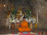 Meditating monk in cave temple