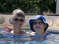 Doreen and I in their swimming pool