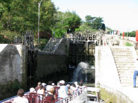 A tourist boat going through the lock