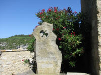 Memorial at Minerve featuring a dove, in memory of the Cathars burnt to death in 1210. Erected 1982.