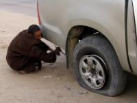 Hamadea changing his bald tyre